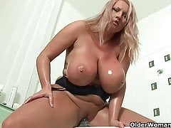 Mature soccer mom with big tits fucks a dildo